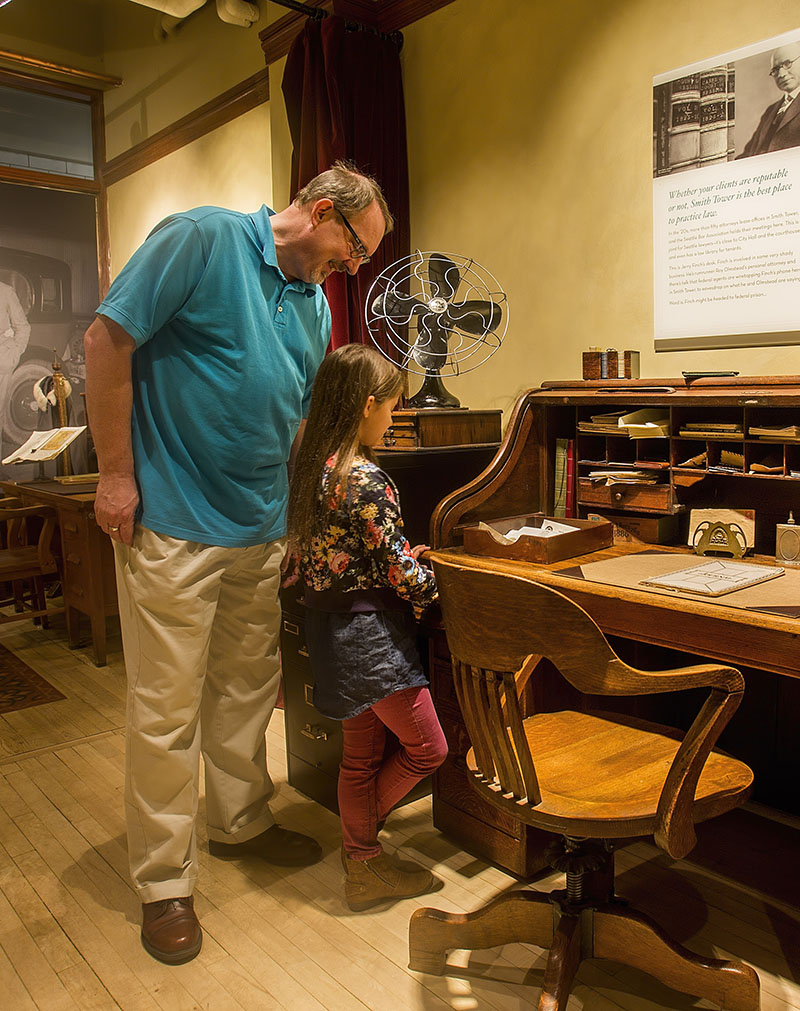 father and daughter viewing exhibits